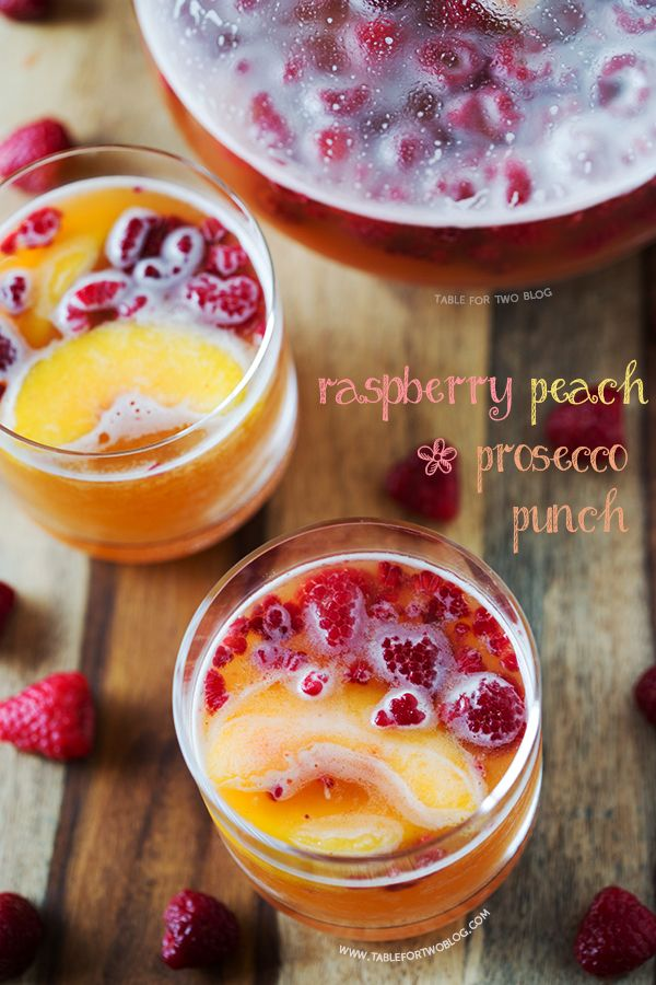 Raspberry Peach Prosecco Punch ~ 12 ounces Frozen Raspberries, 2 cups Peach Nectar, chilled, 1 bottle Prosecco, chilled, Ice