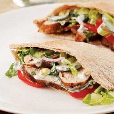 Indian-Spiced Chicken Pitas for Two  Grill spice-rubbed chicken breasts and tuck them into whole-wheat pitas along with fresh vegetables and a tangy yogurt sauce for a warm-weather, low-fat chicken dinner.
