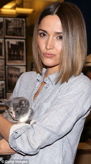 Colour coordination: Rose opted for a light grey shirt which almost matched the cute fur of the little kitten she cuddled