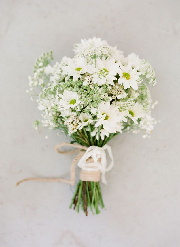 White daisy and baby's breath wedding bouquet. Photography by Jemma Keech Photography via Wed Society.