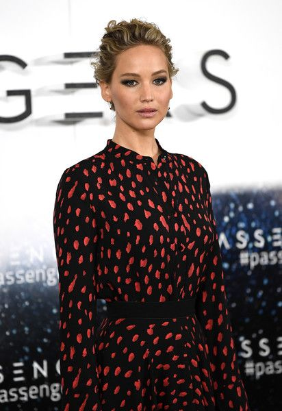 Actress Jennifer Lawrence attends a photocall for the film 'Passengers' in England.