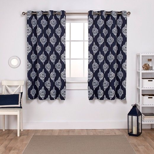 • Sun-blocking and thermal insulated                                                                                                                  <br>• 100% polyester                                                                                                                      <br>• Grommets for durability and easy hanging<br><br>Get privacy and energy-efficiency with this Exclusive Home Set of 2 Medallion Blackout Thermal Curtain P...