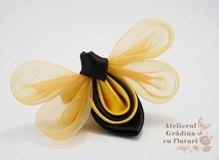 A cute satin and organza kanzashi bee. - For Pioneer Day Decor since the Beehive is Utah's state emblem.