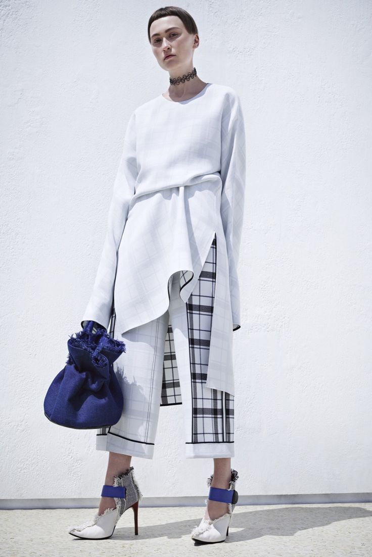 Acne Studios Resort 2016 - Collection - Gallery - Style.com ...totally unwearable as-is and the hair is HIDEOUS, but the proportions are perfect and the details are great...frayed edge bucket bag, dress over cropped wide pants, tucked waist definition...let's see if we can't make this one work for the real world!