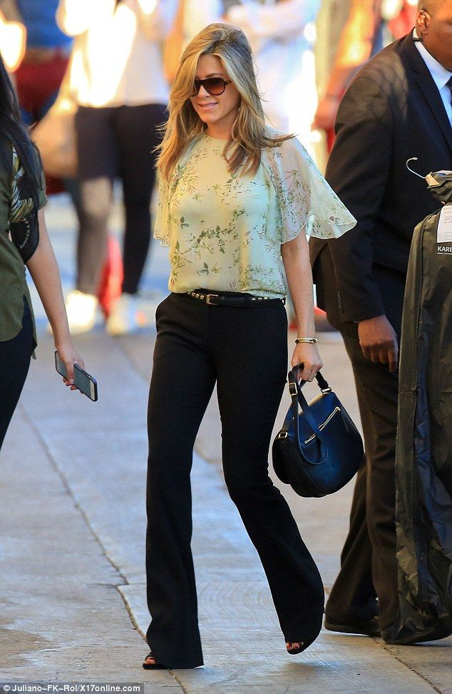 Femininely floral: Jennifer Aniston looked lovely in a delicately patterned blouse as she headed to Jimmy Kimmel Live in LA on Monday