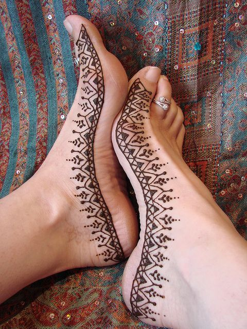 Simple henna design for feet.  NEVER use black henna.  It contains toxic chemicals such as PPD, which is found in hair dye.  The color of a henna design should always be a natural red-brown.