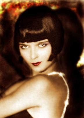 """(This is Louise Brooks) Women have now cut their hair short, with the, """"bob"""" style. Very similar to men. Also their makeup consisted with rouge, lipstick,"""