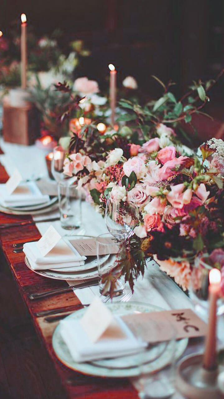 long table setup wedding reception%0A flowerfilled reception table  photo by Pat Furey