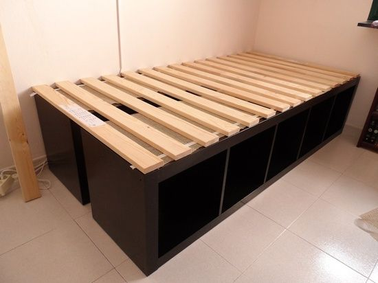 BRILLIANT! especially if you need storage but ALSO need to have a guest bed occasionally. just put the shelves ontop of eachother with the slat bed base behind it and bring out when you need it and top with a foam mattress that can be stored rolled up in a closet or under a bed.... INSTABED.    ikea expedit -----