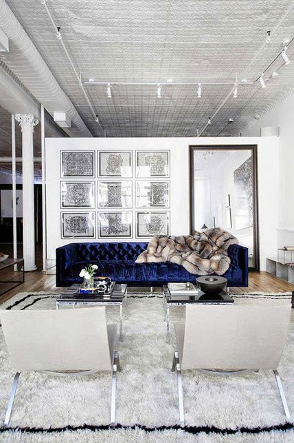 This #monochromatic living room #design is enhanced by the splash of color added with the icy royal blue velvet couch! I enjoy looking at this chilly space. Seems simple enough to recreate!