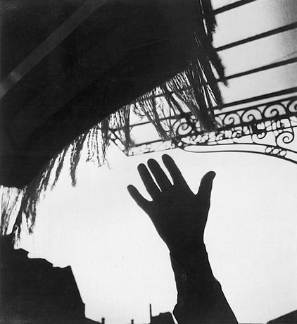 Lee Miller, Untitled, Hand in Silhouette, 1931 OR 1929 Hand reaching for umbrella fringe Paris France?