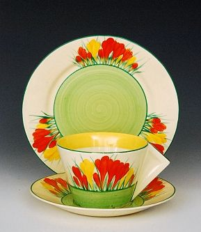 Clarice Cliff - Sungleam Crocus - A Conical cup, saucer and side plate circa 1935 hand painted with Crocus sprays in orange and yellow between yellow and green banding, Bizarre mark