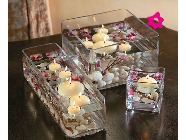 Floating candles can get a little messy but they are so beautiful and go with any centerpiece! #floatingcandles #centerpieces