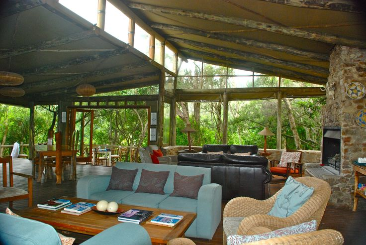 The beautiful relaxing communal lounge area overlooking the bush and river at River Camp at Sibuya Game Reserve in the Eastern Cape of South Africa www.sibuya.co.za