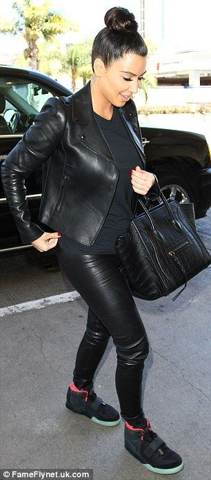 From designer chic to paper pauper! Kim Kardashian swaps Kanye's Air Yeezy trainers, seen right,  for disposable flip flops at nail salon, left
