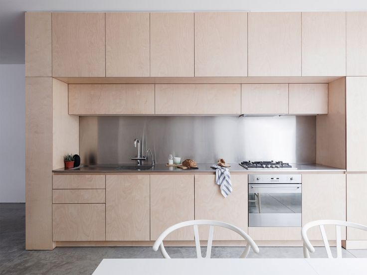 A plywood box hosts the kitchen and staircase in this maisonette in Islington, which has been reconfigured and extended by Larissa Johnston.  ~ Great pin! For Oahu architectural design visit http://ownerbuiltdesign.com