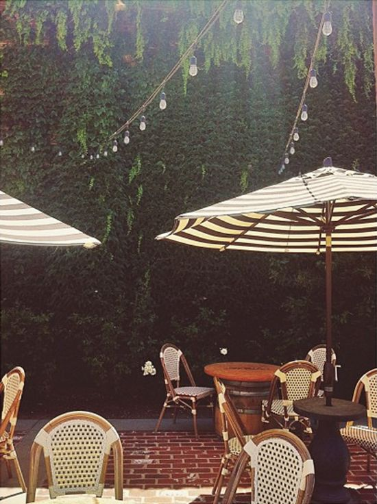 Love the black and white striped parasol and the lights! -coco kelley @casslavalle instagram napa