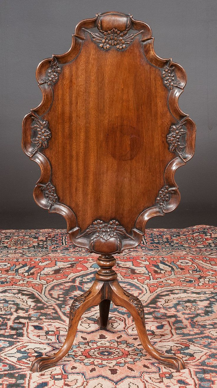 """Chippendale mahogany tripod tip table with scalloped and carved top, acanthus leaf carved column, base has carved knees and ball and claw feet, c.1860, 28"""" long, 21"""" wide, 28"""" high"""