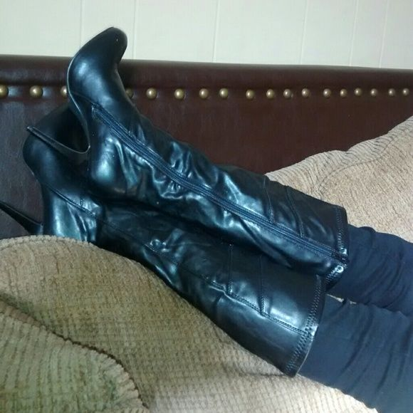 Black boots NWOT Ladies black boots. Zipper inside comes right below the knee about 4 inches. All man made material Shoes Heeled Boots