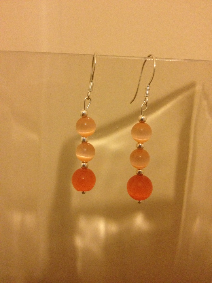 Handmade sterling silver earrings with cats eye beads ... Sold for £5