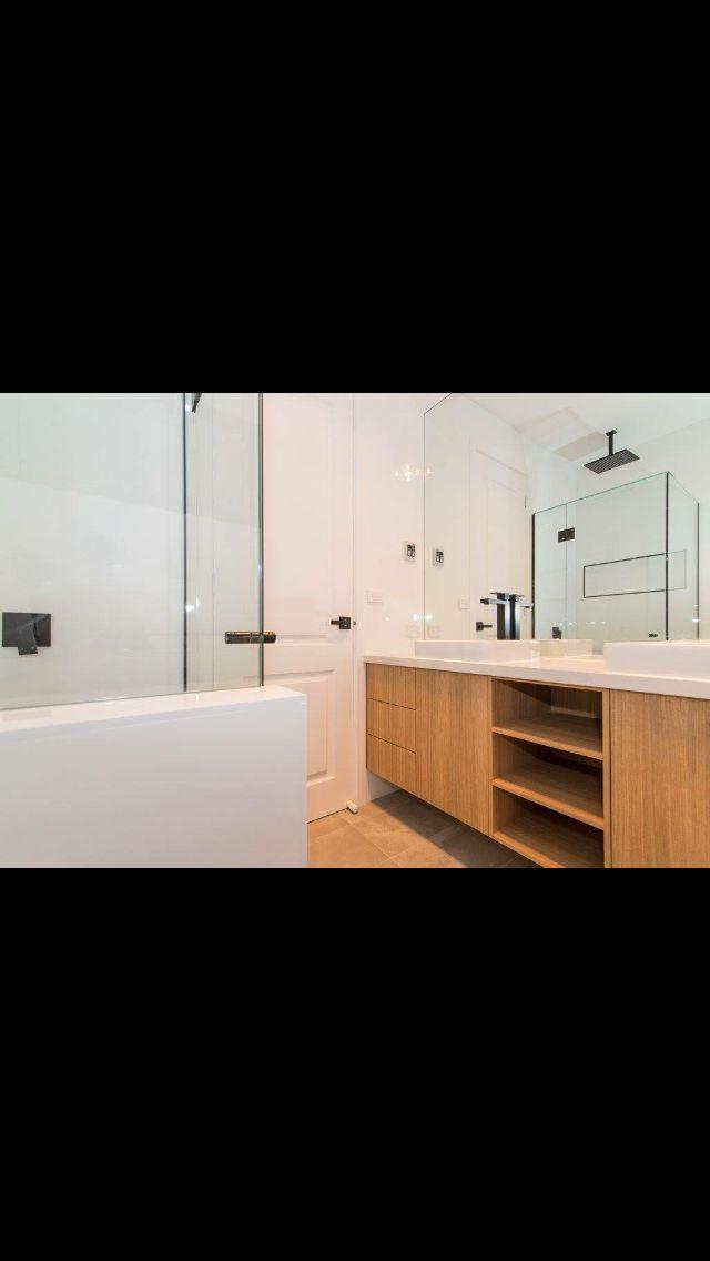 Finished bathroom Thomas street - Meir tapware, Laminex sublime teak, national tiles- Himalayan light grey