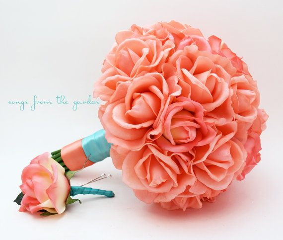 This bridal bouquet of coral Real Touch roses accented with aqua blue and coral ribbon can be part of your beach wedding day! I can create
