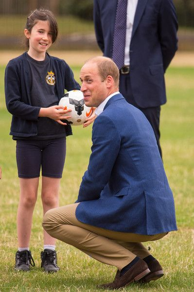 Prince William Photos Photos - Prince William, Duke of Cambridge  joins in football practice with children from the Wildcats Girls' football programme, during a reception for the England Women football team at Kensington Palace on July 13, 2017 in London, England. - The Duke Of Cambridge Hosts A Good Luck Send Off For The England Women Football Team