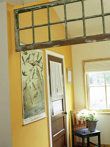Through the Looking Glass - A vintage window makes a stylish substitute for a transom in the passageway between the entry hall and the living room. Old windows are easily found and can be used to add architecture where it might be missing, or even to serve as affordable art.