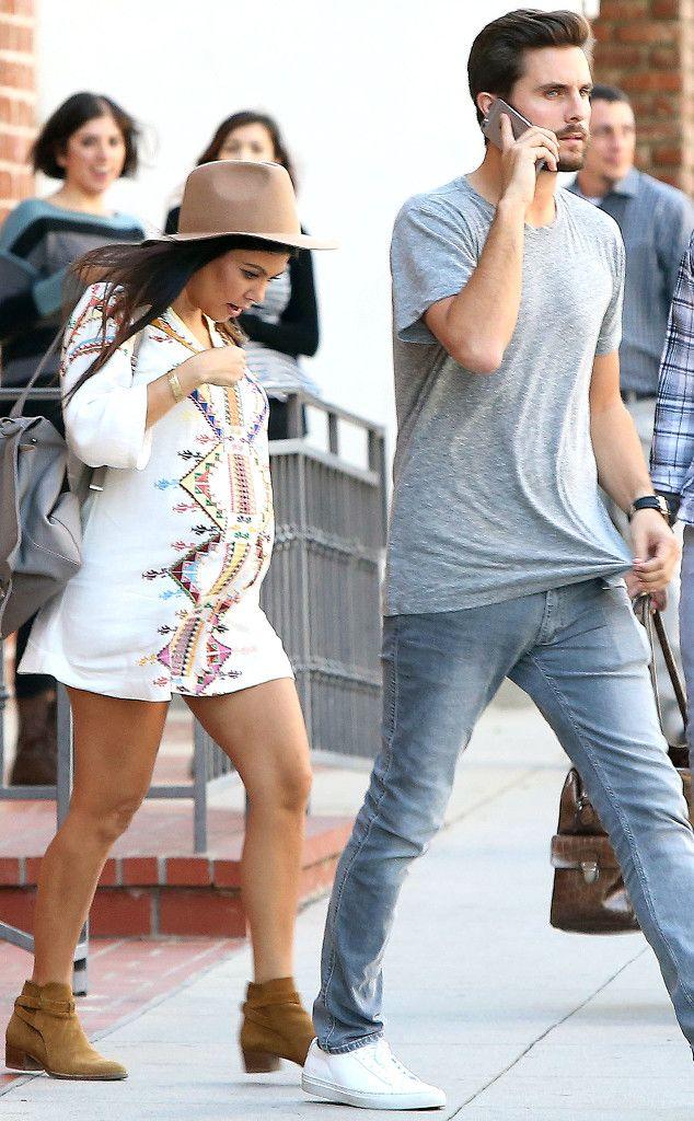 Kourtney Kardashian covers her baby bump in an adorable boho-style T-shirt dress! LOVE!