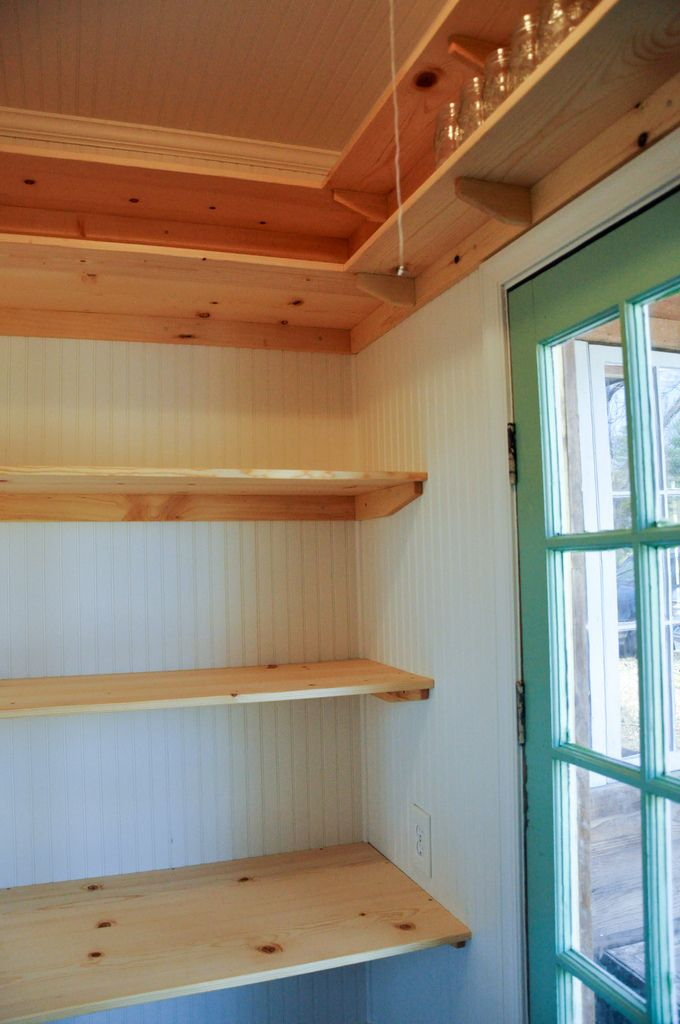 Shelves. No brackets, just wood. Still looks nice and I could add brackets when we can afford them