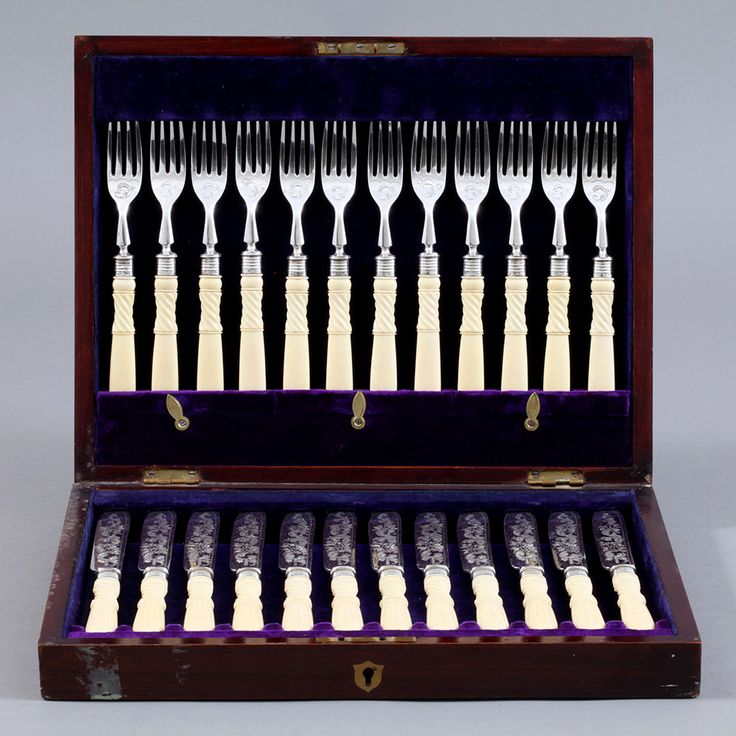Cutlery set  totally 24 pieces. Handle in ivory and final part in silver plated finely engraved by hand. Original box in wood with original velvet inside