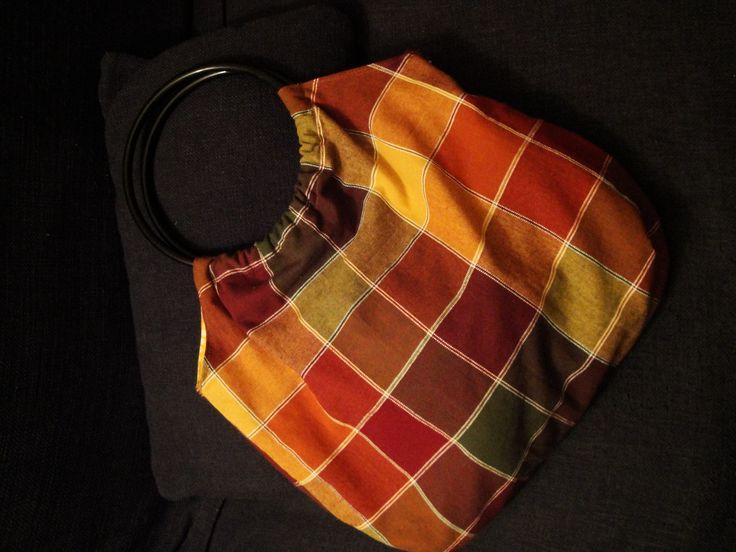 Bag made by PouPée-Pe: using circular plastic  handles.