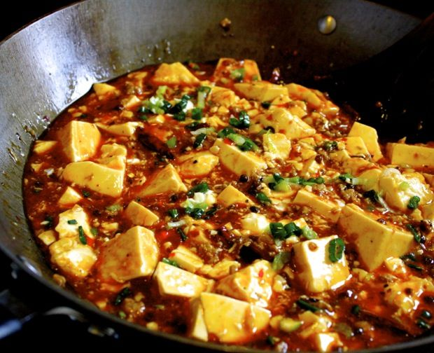 This ma po tofu is the true blue, authentic real deal—the spicy, tongue-numbing, rice-is-absolutely-not-optional, can't-have-just-one-scoop version that you get in the restaurants.