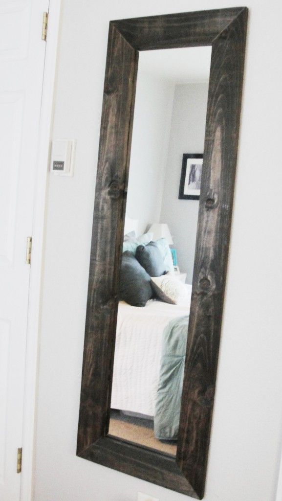 Great idea to update a cheap full length mirror. I want to do this to mine in the bathroom, but I want to paint it black instead.
