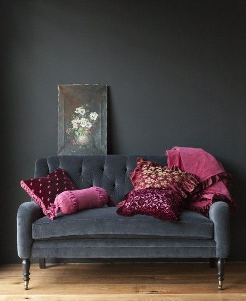 Texture is the easiest way to make a room look lived in. This grey wall and lush vintage velvet settee plays off the  fuschia pillows and throws perfectly. The still life painting is a great piece that pulls it all together. x
