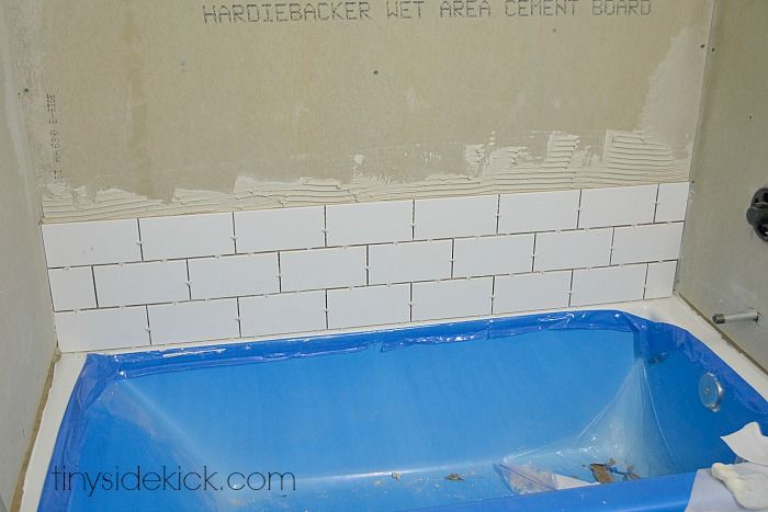 how to install tile around a new bathtub