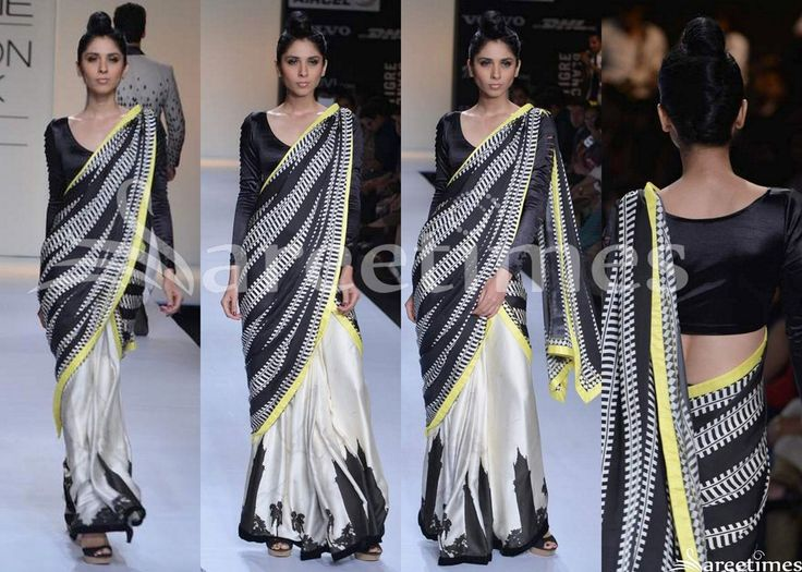 Model displaying beautiful white and black designer half and half saree. Designed by Archana Kocchar at Day 5 LFW Summer/Resort 2013. Black embellished printed work through out border. White printed stripes all over black saree followed by yellow border. Paired with blakc designer full sleeves saree blouse with round neck pattern.