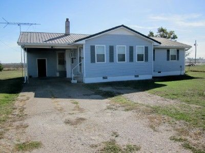 Country Living near Wardell! Offering a 3 bedroom, 1 bath home on paved road near North Pemiscot School and interstate. The metal roof and vinyl siding gives this a low maintenance exterior, fully fenced yard, carport, 2 sheds, propane tank, washer/dryer, stove, refrigerator included. Lot 100 x 150. Mls1445. Listing agent Monica Smith in Wardell MO