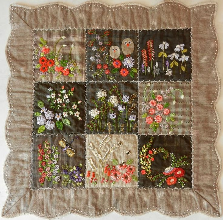 Rather than using patterned fabric, this miniature quilt has been beautifully embroidered with flowers.