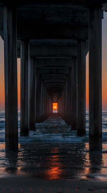 """Scripps Pier sunset alignment in La Jolla, California ~ """"Twice a year, the setting sun lines up with Scripps Pier. May 2, 2013 was such a night."""" • photo: John H. Moore via Scripps_Oceanography on Flickr"""
