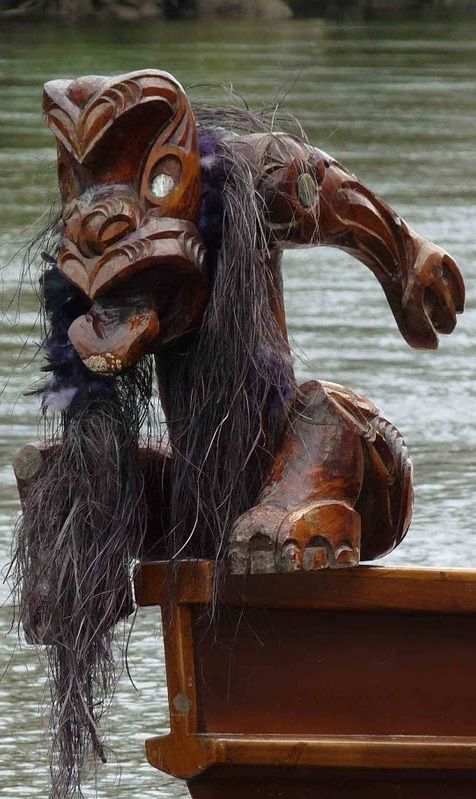Detail of Waka on Waikato River NZ traditional Maori boat