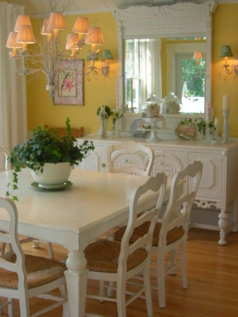 Love everything about this sweet, comfy, dining room, especially the reclaimed buffet and oversized mirror ..