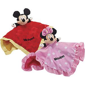 "Disney Baby Snuggle Lovey: Destined to be baby's constant companion! This soft, plush Disney Baby™ lovey is part stuffed animal, part security blanket, and all irresistible, from crinkly mouse ears to a silky band of satin trim. Gives little fingers lots to explore, and at 14""L x 14""W x 4""H, it's perfectly sized for baby to cuddle and later carry..."