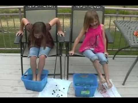 A kids party game. This is a simple kids party game in which kids will race to see how many marbles they can catch with their feet.