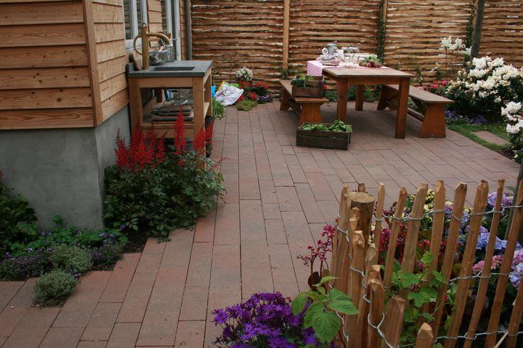 Een Eigen huis en tuin tuin in Hilversum met het Lineair wildverband GeoPiazza in de kleur Varese.