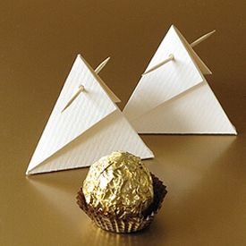 cute triangle packages for tiny gifts....I would use a pretty ribbon to tie it shut tho, instead of a toothpick.