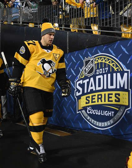 Penguins vs. Flyers - 02/25/2017 - Pittsburgh Penguins - Photos  Sidney Crosby #87 of the Pittsburgh Penguins walks out on the field to warm up before playing in the 2017 Coors Light NHL Stadium Series game