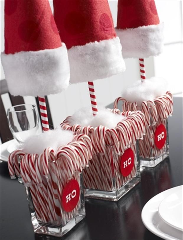 Great Center Piece for your holiday's. Clear glass, some cotton, a few candy canes, small Christmas hats. It is easy and looks terrific.