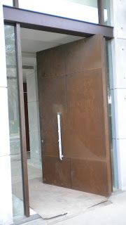 corten steel designs and engineering corten doors and wall by newport