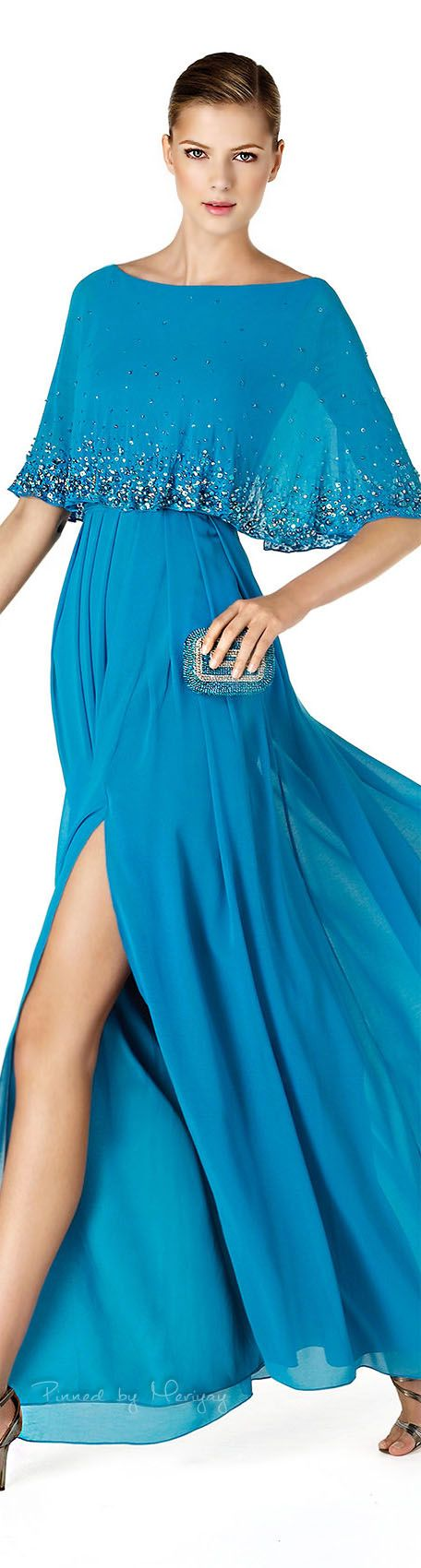 This flowing mother of the bride evening dress covers the upper bodice well. A pretty blue evening gown for the mother of the groom who may be modest. See more mother of the bride options at https://www.dariuscordell.com/featured/custom-made-mother-of-the-bride-evening-dresses/